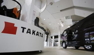 Child seats, manufactured by Takata Corp. are displayed at a Toyota Motor Corp.'s showroom in Tokyo Thursday, Nov. 6, 2014. Takata, the Japanese air bag maker embroiled in a massive recall totaling some 12 million vehicles globally, says it's taking more special losses for new recalls and will sink deeper into the red for the fiscal year. Takata said Thursday it will record a 25 billion yen ($218 million) loss for the fiscal year through March 2015. It previously forecast a 24 million yen ($210 million) forecast. (AP Photo/Shizuo Kambayashi)