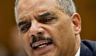 FILE - In this May 15, 2014 file photo Attorney General Eric Holder reacts to aggressive questioning from Rep. Darrell Issa, R-Calif. as he testifies on Capitol Hill in Washington. Newly released emails show Holder used terse language to describe his feelings about some Justice Department prosecutors who were critical of him during the fallout from the Fast and Furious gun-walking scandal. (AP Photo/J. Scott Applewhite)