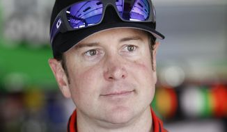 FILE - This is a May 22, 2014, file photo showing Kurt Busch waiting by his car before practice for the NASCAR Sprint Cup series Coca-Cola 600 auto race at Charlotte Motor Speedway in Concord, N.C. Police in Delaware say they are investigating a domestic assault allegation made against NASCAR driver Kurt Busch. The Dover Police Department said in a statement Friday, Nov. 7, 2014,  that the allegations were brought to the department on Wednesday. His ex-girlfriend, Patricia Driscoll, said the allegations involved an incident inside his motorhome at a race. (AP Photo/Terry Renna, File)