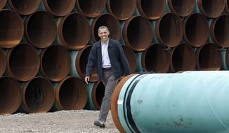 President Barack Obama arrives at the TransCanada Stillwater Pipe Yard in Cushing, Okla., on March 22, 2012. (Associated Press)