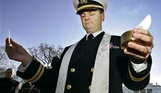Navy Chaplain Lt. Gordon J. Klingenschmit in front of the White House on Jan. 7, 2006. (Associated Press) ** FILE **