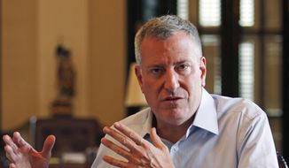 """It's """"a smart policy that keeps New Yorkers safe, but it is also a more fair policy,"""" said Mayor Bill de Blasio, a first-term Democrat who's faced pressure to keep campaign promises to reduce the more than 20,000 such arrests per year. (Associated Press)"""