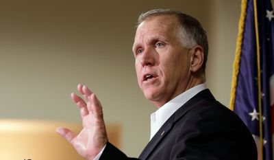 U.S. Sen.-elect Thom Tillis answers a question from the media during a news conference in Charlotte, N.C., Wednesday, Nov. 5, 2014. Tillis unseated Democratic Sen. Kay Hagan in Tuesday's election, narrowly winning a race that attracted more than $100 million in spending from the candidates and outside groups and that proved to clinch the Senate majority for the GOP. (AP Photo/Chuck Burton)