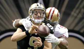 New Orleans Saints quarterback Drew Brees (9) is about to be sacked by San Francisco 49ers outside linebacker Ahmad Brooks (55) during an NFL football game at the Superdome in New Orleans, Sunday, Nov. 9, 2014. (AP Photo/NOLA.com The Times-Picayune, David Grunfeld) THE BATON ROUGE ADVOCATE, MAGS OUT, NO SALES, USA TODAY OUT
