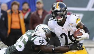 New York Jets' Demario Davis (56) tackles Pittsburgh Steelers' Le'Veon Bell (26) during the second half of an NFL football game Sunday, Nov. 9, 2014, in East Rutherford, N.J. (AP Photo/Bill Kostroun)
