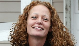Kaci Hickox comes out of her house to speak to reporters, in Fort Kent, Maine, in this Oct. 31, 2014, file photo. (AP Photo/Robert F. Bukaty, File)