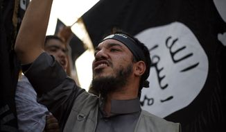 A Libyan follower of Ansar al-Shariah Brigades chants anti-U.S. slogans during a protest in front of the Tibesti Hotel, in Benghazi, Libya, on Sept. 14, 2012 (Associated Press) ** FILE **