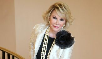 """This Oct. 5, 2009, file photo shows Joan Rivers posing as she presents """"Comedy Roast with Joan Rivers"""" during the 25th MIPCOM (International Film and Programme Market for TV, Video, Cable and Satellite) in Cannes, southeastern France. The comedian, who was 81, died Sept. 4, 2014. (AP Photo/Lionel Cironneau, File)"""