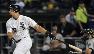 Chicago White Sox's Jose Abreu watches his double during the first inning of a baseball game against the Oakland Athletics in Chicago, Wednesday, Sept. 10, 2014. (AP Photo/Paul Beaty)