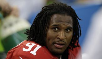 Then-San Francisco 49ers' Ray McDonald (91) sits on the bench during the second half of an NFL football game against the Dallas Cowboys, Sunday, Sept. 7, 2014, in Arlington, Texas. (AP Photo/LM Otero)
