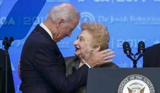 Vice President Joe Biden is introduced by Holocaust survivor Nesse Godin as he arrives to address the Jewish Federations of North America General Assembly at the Gaylord National Harbor Convention Center in Oxon Hill, Md., Monday, Nov. 10, 2104. (AP Photo/J. Scott Applewhite)