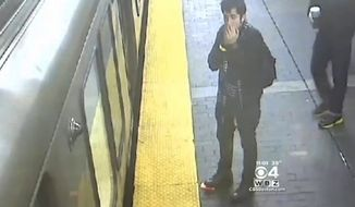 Josue Gonzalez, 26, has turned himself into police after surveillance video captured him witnessing a woman get killed by a subway train and then swiping her cell phone, police said. (WBZ 4)