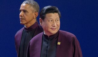 President Barack Obama and Chinese President Xi Jinping arrive for  the Asia-Pacific Economic Cooperation (APEC) Summit family photo, Monday, Nov. 10, 2014 in Beijing. (AP Photo/Pablo Martinez Monsivais)