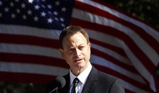 Actor Gary Sinise, a Memorials National spokesman, speaks at the groundbreaking ceremony for the American Veterans Disabled for Life Memorial in Washington in this Nov 10, 2010, file photo. (AP Photo/Jacquelyn Martin, File)