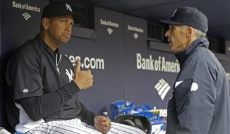 FILE - In this April 13, 2013, file photo, New York Yankees' Alex Rodriguez, who is on the disabled list after his hip surgery, talks to New York Yankees manager Joe Girardi during a baseball game against the Baltimore Orioles at Yankee Stadium in New York. Girardi won't know until March what to expect of Alex Rodriguez in 2015. Rodriguez was limited to 44 games in 2013 following hip surgery, then was suspended for all of this season for violations of baseball's drug agreement and labor contract.  (AP Photo/Kathy Willens, File)