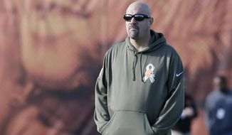 Cleveland Browns head coach Mike Pettine watches practice at the NFL football team's training camp Tuesday, Nov. 11, 2014, in Berea, Ohio. The Browns took an unexpected trip over their long weekend, into first place in the AFC North. Cleveland is alone atop the division for the first time since 1994, when starting quarterback Brian Hoyer was a 9-year-old kid dreaming of one day throwing touchdowns for his hometown team. (AP Photo/Tony Dejak)