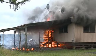 In this image from video provided by the County of Hawaii, lava flow from the Kilauea volcano burns a residential structure Monday, Nov. 10, 2014, in Pahoa, Hawaii. (AP Photo/County of Hawaii)