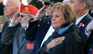 Gov. Susana Martinez holds her hand over her heart as the Pledge of Allegiance is recited during a Veterans Day ceremony at the New Mexico Veterans Memorial in Albuquerque, N.M., on Tuesday, Nov. 11, 2014. (AP Photo/Susan Montoya Bryan) ** FILE **