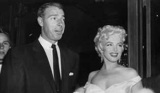 In this June 2, 1955 file photo, actress Marilyn Monroe, right, dressed in a glamorous evening gown, arrives with Joe DiMaggio at the theater. (Associated Press)