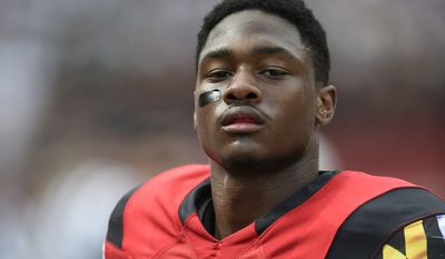 FILE - In this Aug. 30, 2014, file photo, Maryland wide receiver Stefon Diggs (1) looks on before an NCAA college football game against James Madison in College Park, Md. Beating No. 12 Michigan State is a tough enough task for Maryland. Doing it without standout receiver Stefon Diggs makes it even more difficult. (AP Photo/Nick Wass, File)