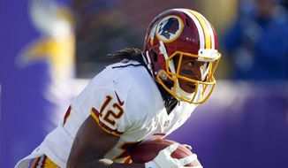 Washington Redskins wide receiver Andre Roberts (12) returns a kick against the Minnesota Vikings during an NFL football game, Sunday, Nov. 2, 2014, in Minneapolis. (Jeff Haynes/AP Images for Panini)