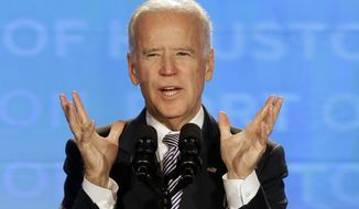 Vice President Joe Biden speaks at an annual convention of port authorities, Wednesday, Nov. 12, 2014, in Houston. The vice president visited Houston to urge port authorities to keep upgrading their facilities.  (AP Photo/Pat Sullivan)