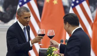 President Obama toasts with Chinese President Xi Jinping at a lunch banquet in the Great Hall of the People in Beijing Wednesday, Nov. 12, 2014. Mr. Obama is on a state visit after attending the Asia-Pacific Economic Cooperation (APEC) summit. (AP Photo/Greg Baker, Pool)