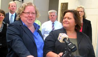 FILE - In this Oct. 15, 2014, file photo, Colleen Condon, left, and her partner Nichols Bleckley appear at a news conference in Charleston, S.C., shortly after filing a federal lawsuit seeking the right to marry in South Carolina. On Wednesday, Nov. 12, 2014, U.S. District Judge Richard Gergel ruled in their favor in the case, striking down the state's same-sex marriage ban as unconstitutional. He gave the state a week to appeal his ruling before marriage licenses will be issued. (AP Photo/Bruce Smith, File)