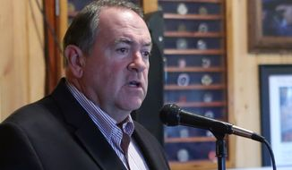 Former Arkansas Gov. Mike Huckabee has taken up a presidential pose, with a new book due out in 10 weeks.  (AP Photo/Steve Cannon) **FILE**