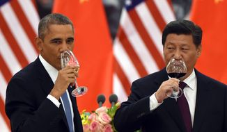 President Obama and Chinese President Xi Jinping continued their talks at an economic summit in the capital city of Beijing. Despite the two nations vowing to curb greenhouse gas emissions, Mr. Obama's detractors say that he should be pressing China harder on economic agreements that keep U.S. interests front and center. (Associated  Press)