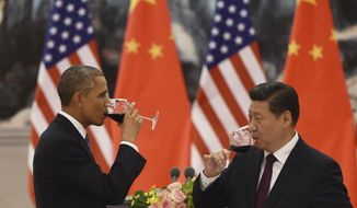 U.S. President Barack Obama, left, and Chinese President Xi Jinping drink a toast at a lunch banquet in the Great Hall of the People in Beijing Wednesday, Nov. 12, 2014. Obama is on a state visit after attending the Asia-Pacific Economic Cooperation summit. (AP Photo/Greg Baker, Pool)