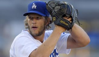 FILE - I this Aug. 16, 2014, file photo, Los Angeles Dodgers pitcher Clayton Kershaw winds up during a baseball game against the Milwaukee Brewers in Los Angeles. Kershaw was named the National League MVP on Thursday, Nov. 13. (AP Photo/Mark J. Terrill, File)