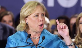 In this photo taken Nov. 4, 2014, Sen. Mary Landrieu, D-La., acknowledges supporters at her election night headquarters in New Orleans. (AP Photo/Bill Haber) ** FILE **