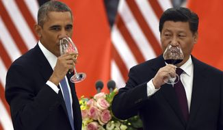 President Obama and Chinese President Xi Jinping drink after a toast during a lunch banquet in the Great Hall of the People in Beijing on Nov. 12, 2014. (Associated Press) **FILE**