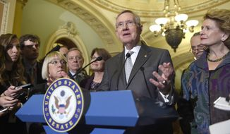 Senate Majority Leader Harry Reid of Nev. speaks to reporters on Capitol Hill in Washington, Thursday, Nov. 13, 2014, after Senate Democrats voted on leadership positions for the 114th Congress. From left are, Sen. Patty Murray, D-Wash., Senate Majority Whip Richard Durbin of Ill., Sen. Amy Klobuchar, D-Minn., Sen. Charles Schumer, D-N.Y., and Sen. Debbie Stabenow, D-Mich. (AP Photo/Susan Walsh)