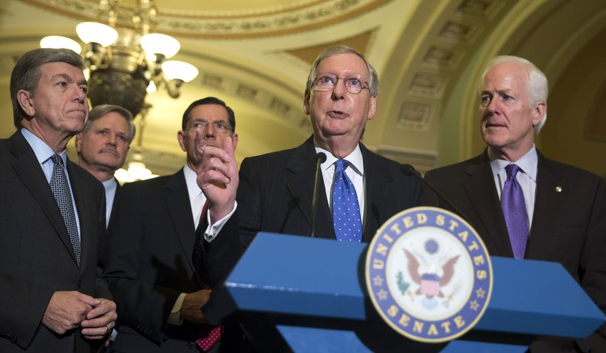 Senate Minority Leader Sen. Mitch McConnell of Ky., speaks during a news conference on Capitol Hill in Washington, Thursday, Nov. 13, 2014, after Senate Republicans voted on leadership positions for the 114th Congress. From left are, Sen. Roy Blunt, R-Mo., Sen. John Hoeven, R-N.D., Sen. John Barrasso, R-Wyo., McConnell and Senate Minority Whip John Cornyn of Texas  (AP Photo/Evan Vucci)