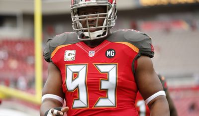 Tampa Bay Buccaneers defensive tackle Gerald McCoy (93) walks onto the field before the start of an NFL football game against the Atlanta Falcons on Sunday, Nov. 9, 2014, in Tampa, Fla. (AP Photo/Brian Blanco)