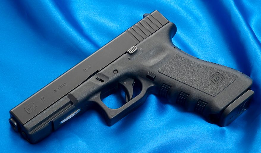 """GLOCK 17- A polymer-framed, short recoil operated, locked breech semi-automatic pistols designed and produced by Glock Ges.m.b.H., located in Deutsch-Wagram, Austria. It entered Austrian military and police service by 1982. Despite initial resistance from the market to accept a """"plastic gun"""" due to durability and reliability concerns, and fears that the pistol would be """"invisible"""" to metal detectors in airports, Glock pistols have become the company's most profitable line of products, commanding 65% of the market share of handguns for United States law enforcement agencies as well as supplying numerous national armed forces and security agencies worldwide. Glocks are also popular firearms amongst civilians for recreational/competition shooting, home/self defense and concealed/open carry."""