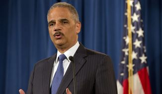Attorney General Eric Holder speaks during a news conference at the Justice Department in Washington, Thursday, Nov. 13, 2014, with Italy's Minister of Justice Andrea Orlando, and Dimitris Avramopoulos, EU Commissioner for Migration, Home Affairs, and Citizenship, after their meeting. (AP Photo/Jacquelyn Martin)