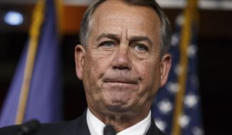 """Speaker of the House John Boehner, R-Ohio, takes questions as he meets with reporters on Capitol Hill in Washington, Thursday, Nov. 13, 2014. With President Barack Obama poised to unveil a series of executive actions on immigration, Boehner said """"We're going to fight the president tooth and nail if he continues down this path. This is the wrong way to govern. This is exactly what the American people said on Election Day they didn't want."""" (AP Photo/J. Scott Applewhite)"""