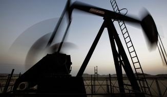 In this Oct. 14, 2014 file photo, an oil pump works at sunset in the desert oil fields of Sakhir, Bahrain. The price of oil took another sharp tumble Thursday, Nov. 13, 2014, as it appeared increasingly unlikely that OPEC members will cut production to staunch a plunge in prices that is entering its fifth month. (AP Photo/Hasan Jamali, File)