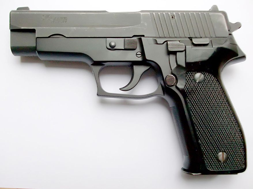 SIG P226 - a full-sized, service-type pistol made by SIG Sauer. It is chambered for the 9×19mm Parabellum, .40 S&W, .357 SIG, and .22 Long Rifle. It is essentially the same basic design of the SIG P220, but developed to use higher capacity, staggered-column magazines in place of the single-column magazines of the P220. The P226 itself has spawned further sub-variants; the P228 and P229 are both compact versions of the staggered-column P226 design. The SIG Sauer P226 and its variants are in service with numerous law enforcement and military organizations worldwide.