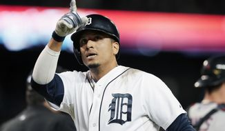 FILE - In this Sept. 13, 2014, file photo Detroit Tigers designated hitter Victor Martinez points to the stands after his solo home run during the fourth inning of a baseball game against the Cleveland Indians in Detroit. A person with knowledge of the deal says the Tigers have agreed to a $68 million, four-year contract with slugger Victor Martinez. The person spoke on condition of anonymity to The Associated Press because the agreement has not been announced. (AP Photo/Carlos Osorio)