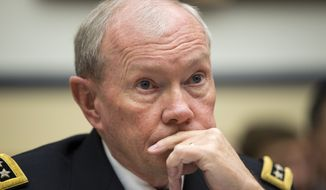 Joint Chiefs Chairman Gen. Martin Dempsey listens on Capitol Hill in Washington, Thursday, Nov. 13, 2014, while testifying before the House Armed Services committee hearing on the Islamic State group. (AP Photo/Evan Vucci)