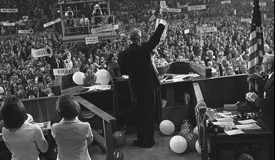 FILE - In this July 16, 1964 file photo, Barry Goldwater waves to delegates inside the Cow Palace at the Republican National Convention in San Francisco. There was a time when the Cow Palace, a cavernous exposition hall built near San Francisco's old beef slaughterhouses, was a revolving door for the country's most famous personalities. Within a span of months in 1964, the Cow Palace staged Wilt Chamberlain, the Beatles and Barry Goldwater at signature moments in their careers. But the picture is much different 46 years later. The arena aged and fell into a state of financial disarray and physical disuse. As budget woes paralyzed California lawmakers every summer, the landmark has faced threats that it would be shuttered and sold. (AP Photo/File)