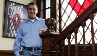 Jonathan Gruber poses in his home in Lexington, Mass., in this Feb. 8, 2011, file photo. (AP Photo/Charles Krupa, File)