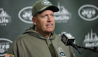 FILe - In this Nov. 10, 2014, file photo, New York Jets head coach Rex Ryan speaks during a news conference after an NFL football game against the Pittsburgh Steelers in East Rutherford, N.J. Ryan has been fined $100,000 for his postgame use of profanity that was picked up on video last Sunday after the game against the Steelers. (AP Photo/Bill Kostroun, File)