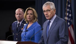 Defense Secretary Chuck Hagel speaks during a news conference at the Pentagon, Friday, Nov. 14, 2014, where he announced that he is ordering top-to-bottom changes in how the nation's nuclear arsenal is managed, vowing to invest billions of dollars more to fix what ails a force beset by leadership lapses, security flaws and sagging morale. From left are, Air Force Global Strike Command Commander Lt. Gen. Stephen Wilson, Air Force Secretary Deborah Lee Jones, and Hagel. (AP Photo/Evan Vucci)