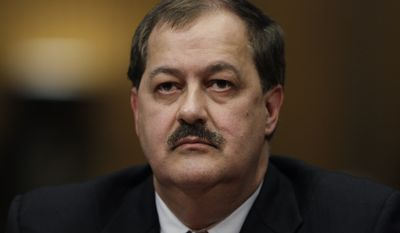 In this May 20, 2010 photo, Massey Energy Company Chief Executive Officer Don Blankenship pauses as he testifies on Capitol Hill in Washington. The former CEO who oversaw the West Virginia mine that exploded in 2010, killing 29 people, has been indicted on federal charges related to a mine safety investigation. U.S. Attorney Booth Goodwin said a federal grand jury indicted Blankenship on Thursday, Nov. 13, 2014. (AP Photo/Carolyn Kaster, File)FILE -