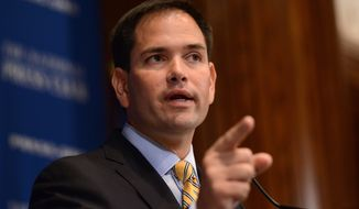 In this May 13, 2014, file photo, Sen. Marco Rubio, R-Fla., speaks at the National Press Club in Washington. (AP Photo/Molly Riley, File)